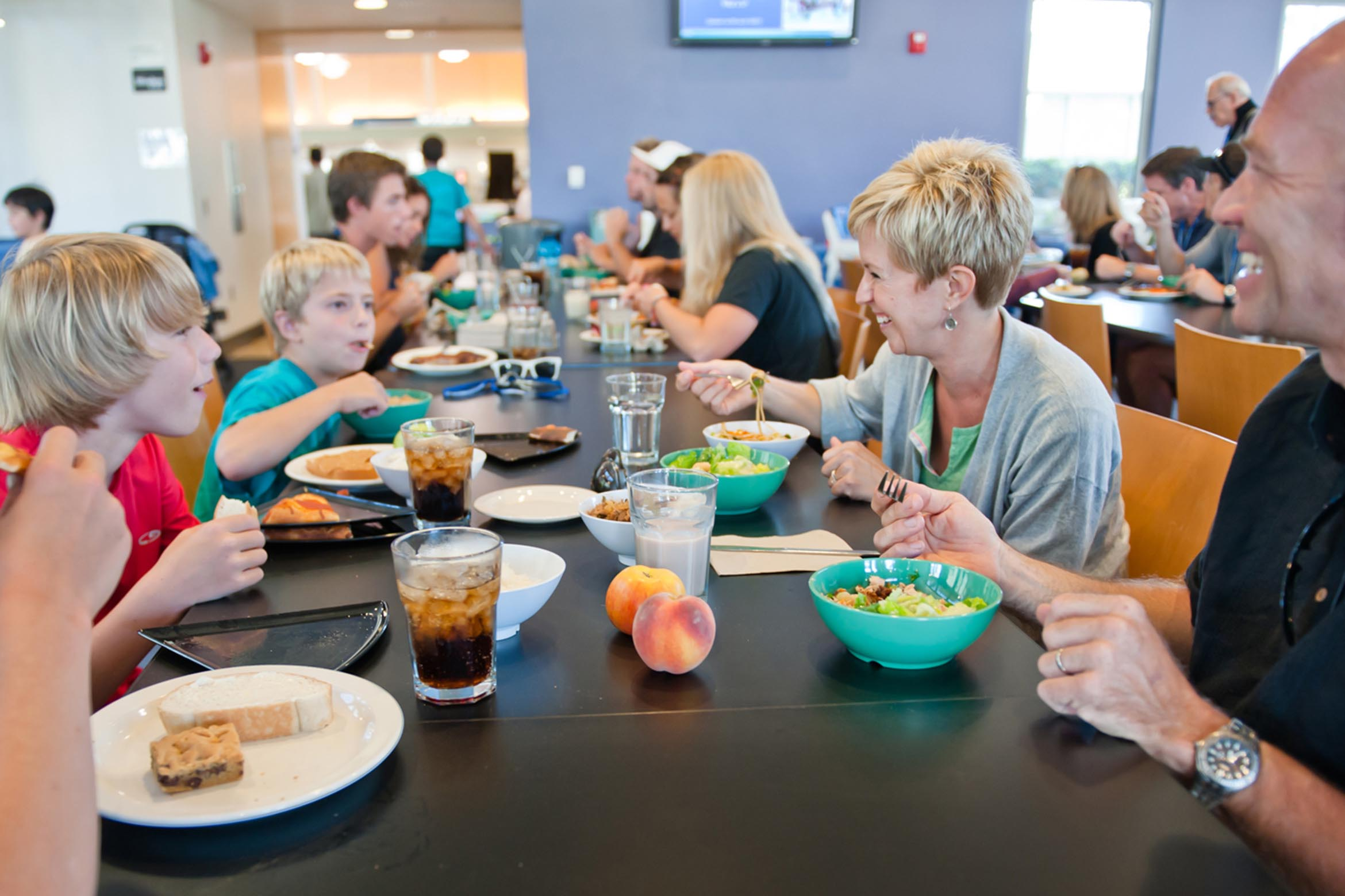 Family eating a meal together in the dining commons.