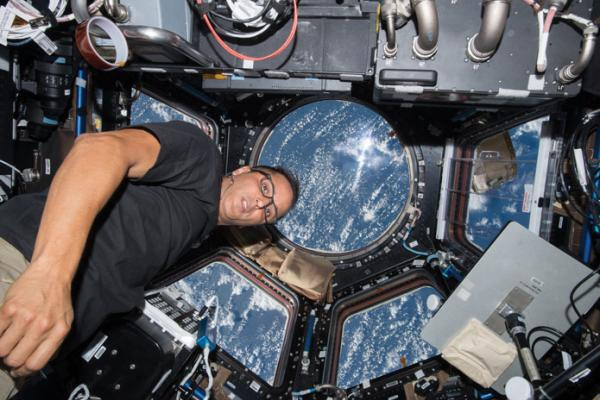 NASA astronaut Joe Acaba works inside the cupola as the space station orbits above the Indian Ocean near Australia. Photo: NASA Johnson